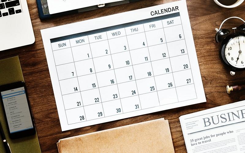 Business calendar flat lay
