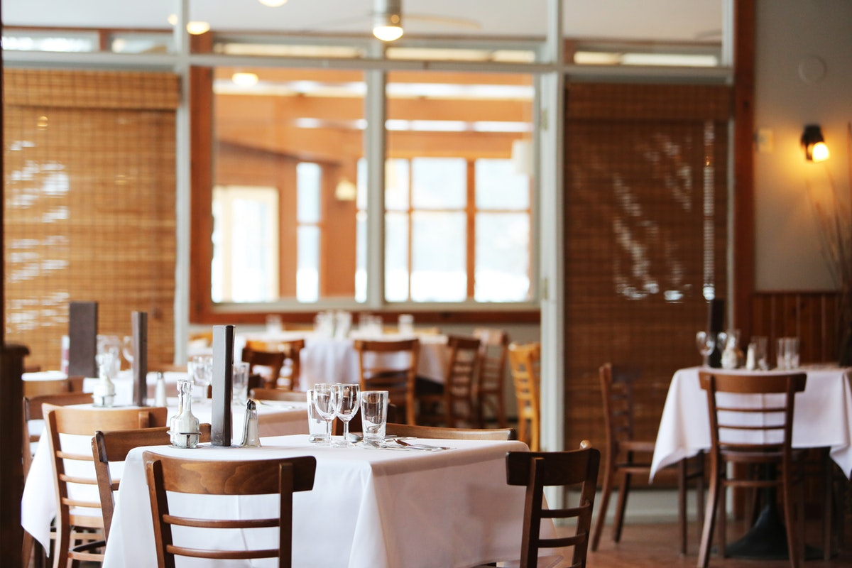 inside of restaurant dining room without customers
