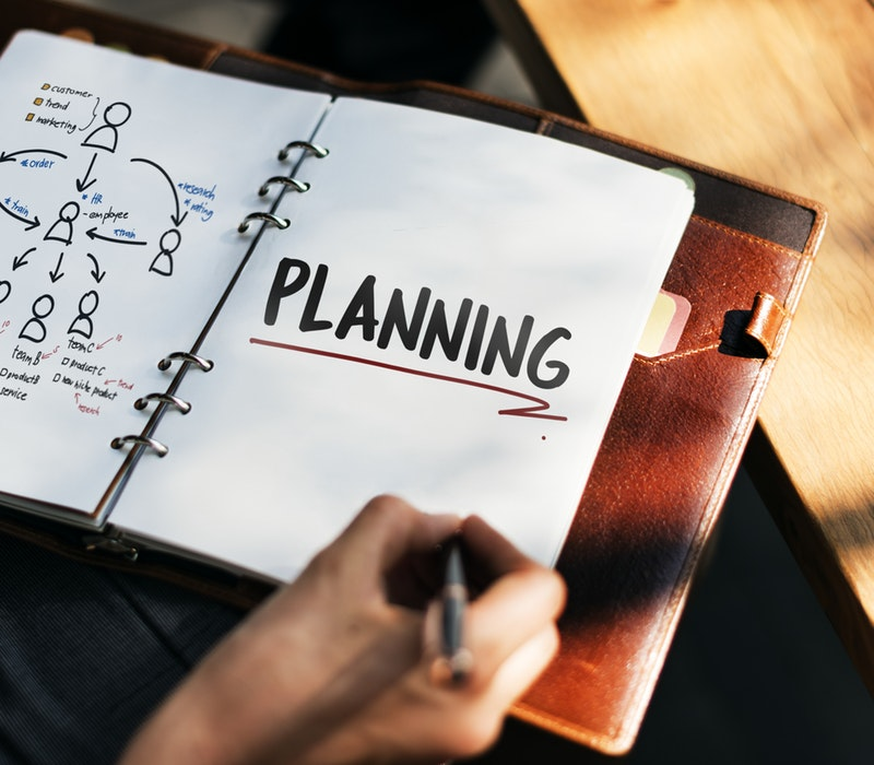 "Planner with the word ""Planning"" written"