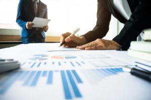 Business value paperwork on desk