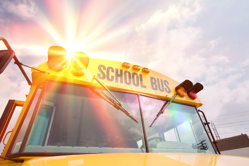 School bus with sun flare