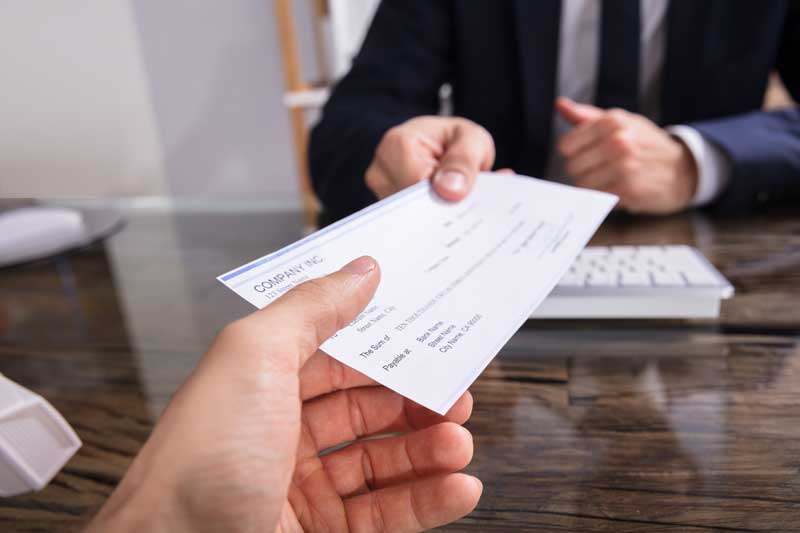 Showing man giving a business check