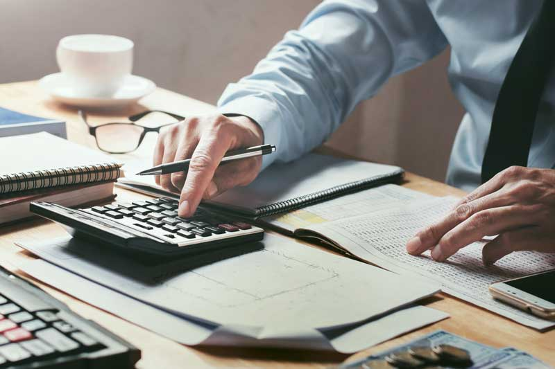 Man working on financial statement reporting