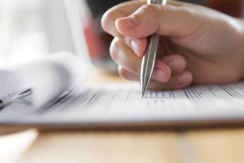 person completing application form